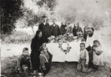Romero family at funeral of young child, December 21, 1890