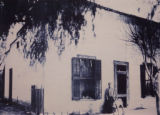 Petra Stevens and dog in front of Stevens House, circa 1890