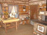 1884  Log cabin kitchen area