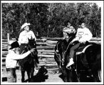 O.T. Gillette and visitors on horseback at Buffalo Park in Flagstaff [constructed title], ca. 1965.