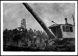 Workers and children on logging railroad equipment operated by the McGonigle Lumber Co. in...